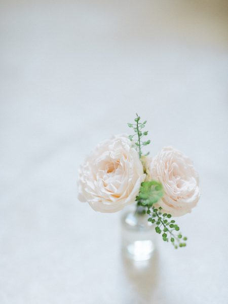 Blush antique rose corsage from Fairy Nuff flowers in a pretty bottle for a London wedding