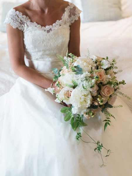 Bride holding a blush and cream antique rose and peony relaxed wedding flowers bouquet from Fairy Nuff flower for a London wedding