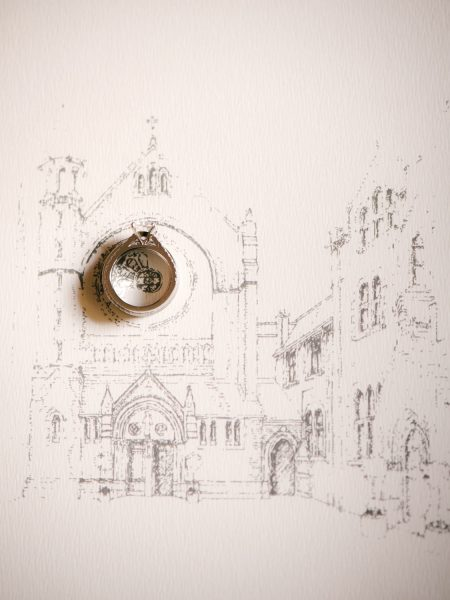 Fine Art Portrait of Engagement Ring on wedding invitation featuring a hand drawing of The Oratory church in Oxford for a chic Oxford wedding