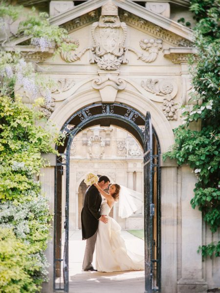 Fine Art Portrait of Bride and Groom in an Oxford University Archway in a sculptural dress Bodleian Library wedding for a classic chic Oxford wedding