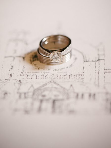 Fine Art Portrait of wedding Rings on wedding invitation featuring a hand drawing of The Oratory church in Oxford for a chic Oxford wedding