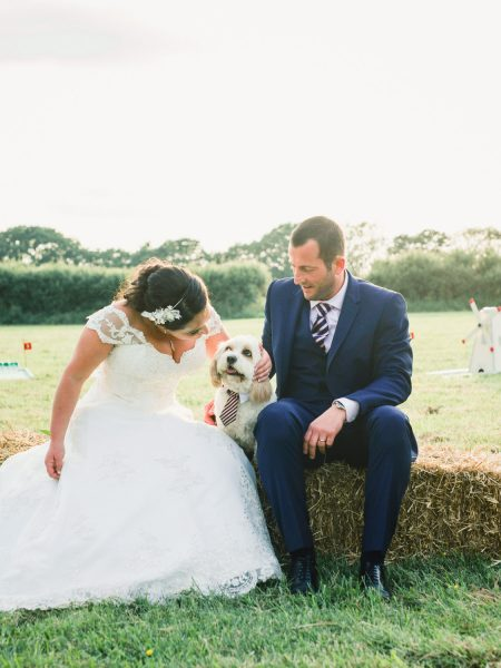 Overall portrait of Bride Groom and wedding dog with tie at a relaxed country Sussex wedding