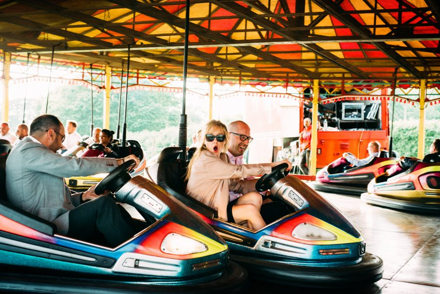 Guest enjoy dodgems at a relaxed country Sussex fairground wedding