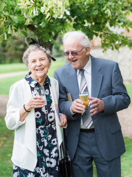 Natural candid moment of Happy Grandparents guests laughing. Taken at a relaxed Summer wedding Tithe Barn Petersfield