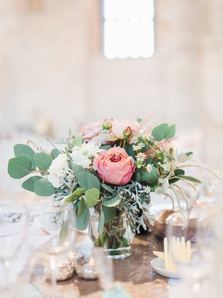 Close up of a Dreamy pink antique rose cream florals with eucalyptus on gold sequin table cloth from Catkin & Pussywillow Winchester
