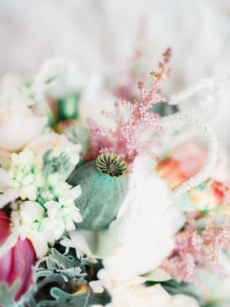 Close up of a Dreamy blush, apricot and cream florals and poppyseed rustic bouquet from Catkin & Pussywillow Winchester