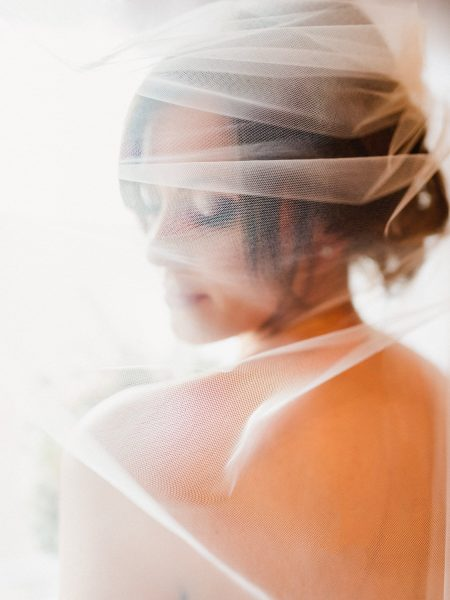 Fine Art natural Bridal Portrait of back of side profile of Bride behind a delicate veil