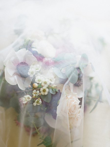 Bridal bouquet with cream anemone rustic country flowers under dreamy veil
