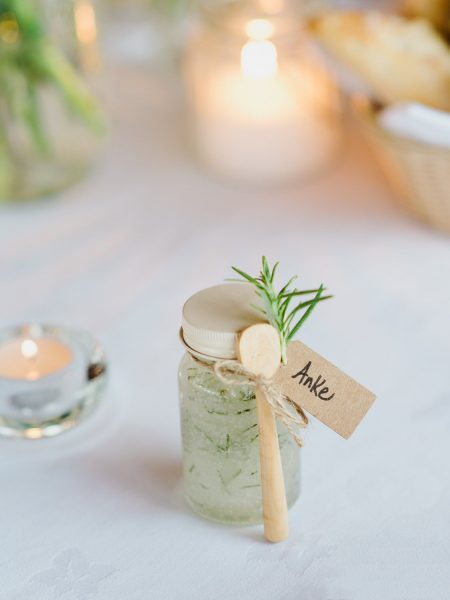 Rosemary wedding guest favour at a Destination wedding in a vineyard Algarve Portugal