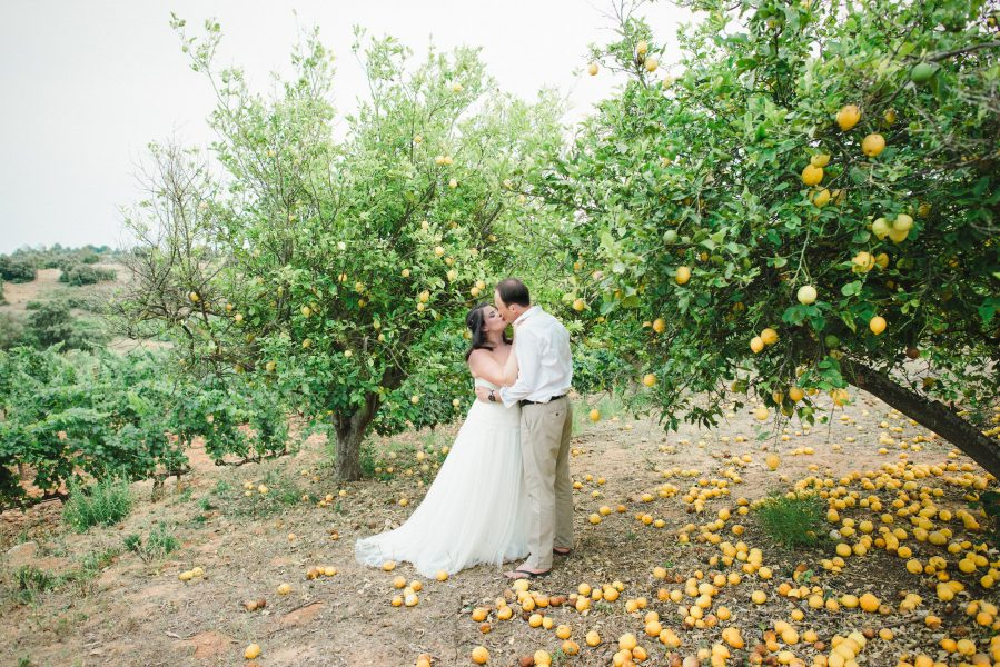 Natural Fine Art portrait of Bride and hugging in a lemon grove during a Destination wedding in a vineyard Algarve Portugal