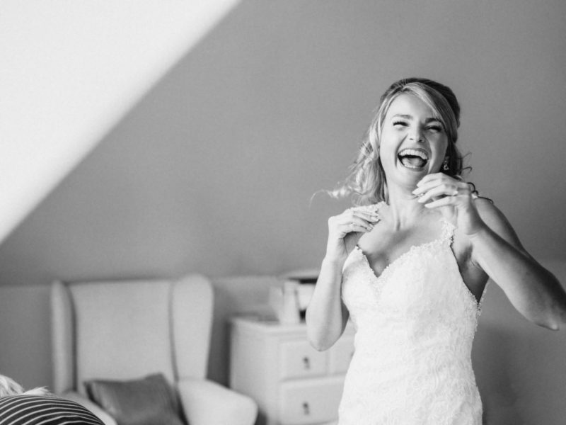 Black and white fine art print of a Bride laughing in a happy Bridal Prep moment
