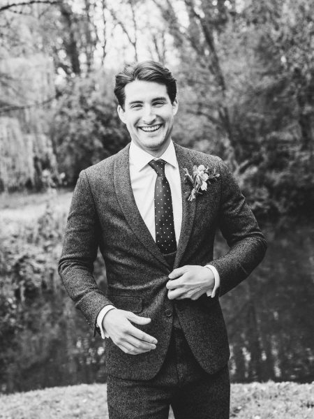 Black and white image of a Groom in tweed suit in an Outwood Surrey wedding