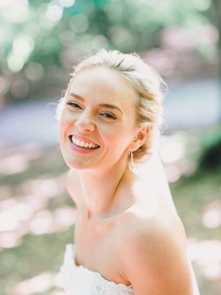 Fine art portrait of a blonde smiling Bride in a Copenhagen wedding