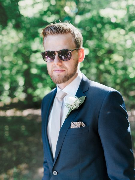 Fine art portrait of Groom in navy suit and cool sunglasses taken in a wood near Charlottenlund Travbane Copenhagen