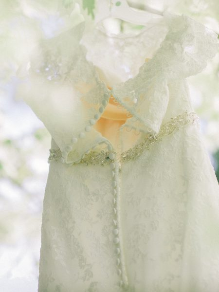 Fine art portrait of back of Bride's lace dress and buttons