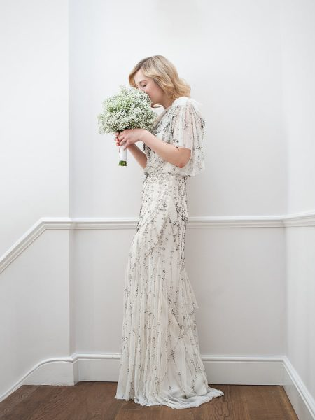 Fine Art bridal portrait of Bride smelling her wedding flowers gypsophila bouquet wearing Jenny Packham crystal beaded one shouldered tulle dress for her London Gherkin wedding