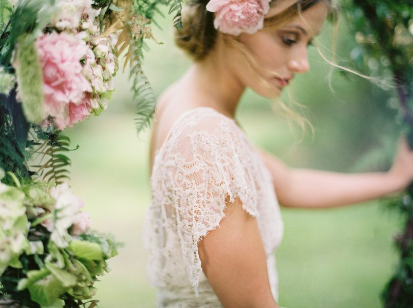 Dreamy Fine Art image of the side view of the Bride with a flower in her hair forest setting wearing a Tara Bradley Birt dress with intricate beading
