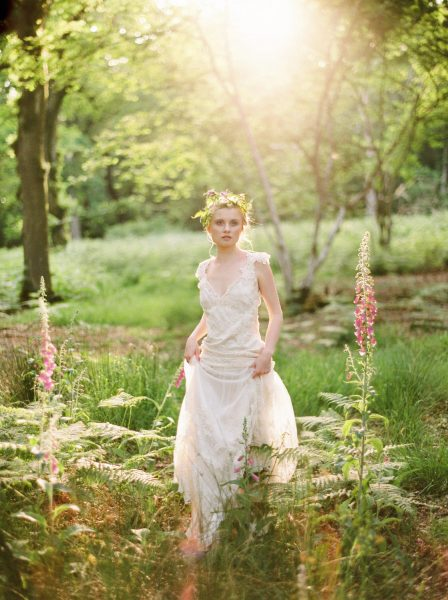 Fine Art fuji400h film full length image of a Bride wearing luxe boho beaded wedding dress and rustic floral crown in a magical forest with fox gloves and evening light for Tara Bradley-Birt bridal fashion shoot