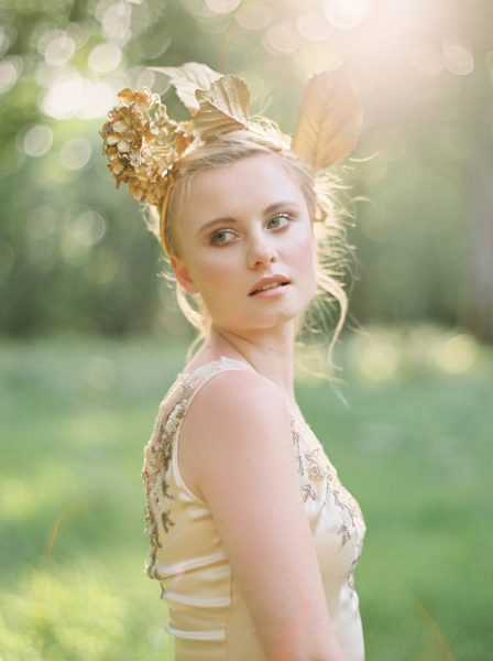 Fine Art fuji400h film portrait image of a Bride wearing a boho gold and beaded gold wedding dress in a magical forest with evening light for Tara Bradley-Birt bridal fashion shoot