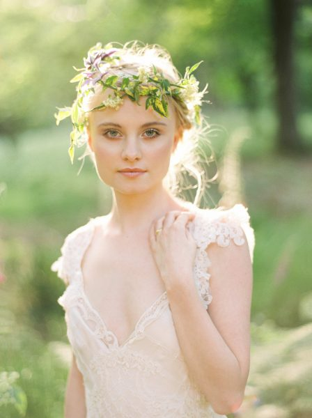 Fine Art fuji400h film close up portrait image of a Bride wearing luxe boho beaded wedding dress and rustic floral crown in a magical forest surrounded by evening light for Tara Bradley-Birt bridal fashion shoot