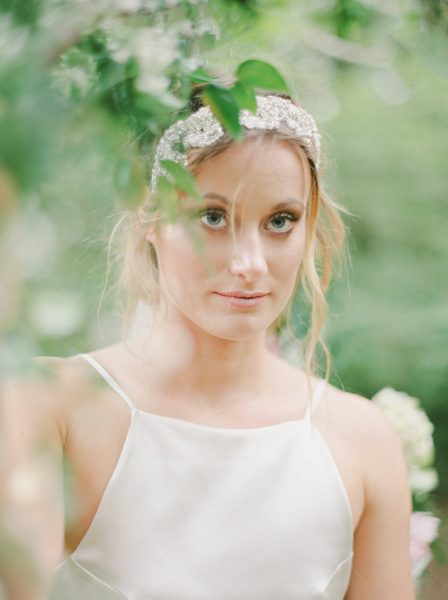 Fine Art fuji400h film close up portrait image of a Bride wearing wedding dress and luxe beaded headdress in a magical forest for Tara Bradley-Birt bridal fashion shoot