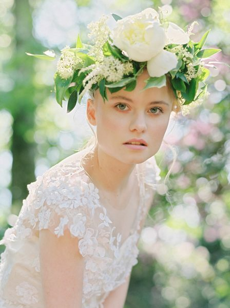 Fine Art fuji400h film portrait image of a Bride wearing a boho floral peony crown and wedding dress in a magical forest with evening light for Tara Bradley-Birt bridal fashion shoot