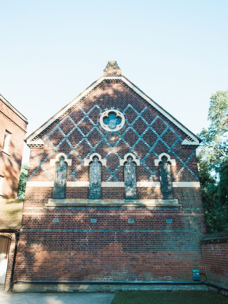 Red and Grey cross hatch bricks Architecture in dappled sunlight at Fulham Palace London