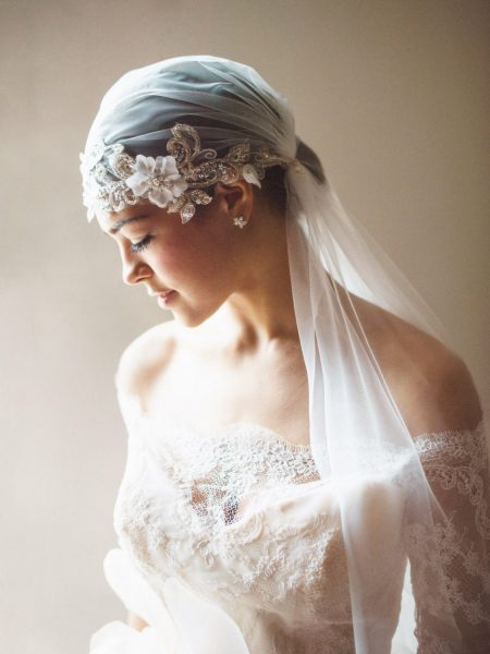Fine Art Bignor Park shoot featuring a close up Portrait of Bride in a veil looking down wearing a Blush tulle dreamy JLM, Tara Keely wedding dress