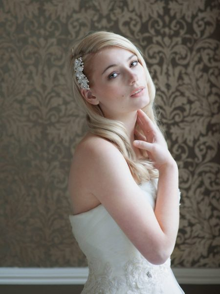 Nonsuch manor Katie Elizabeth of London headpiece shoot featuring blonde model looking at camera against a damask wallpaper