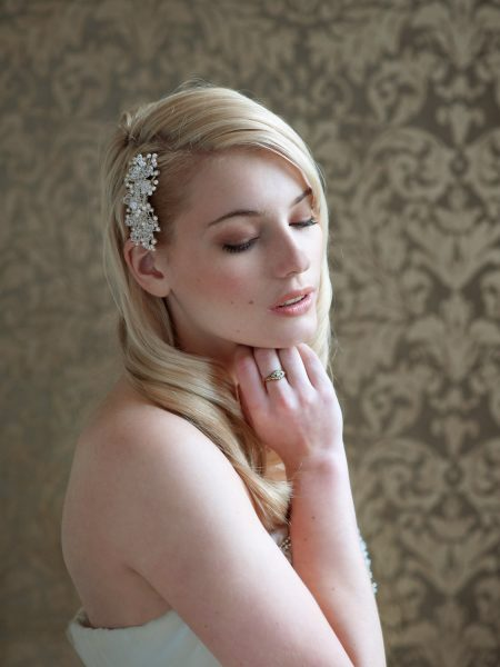 Nonsuch manor Katie Elizabeth of London headpiece shoot featuring blonde model looking down against a damask wallpaper