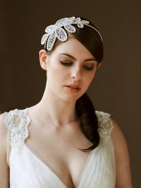 Nonsuch manor Katie Elizabeth of London headpiece shoot featuring brunette model with e large pear headpiece looking down against a