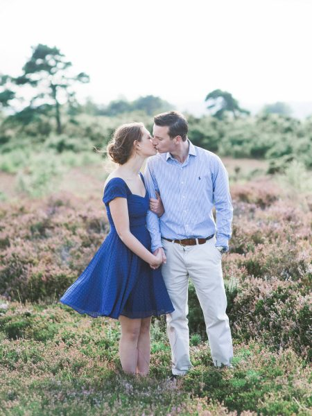 Fine Art engagement shoot of couple kissing against a backdrop of heather heath in Ashdown forest