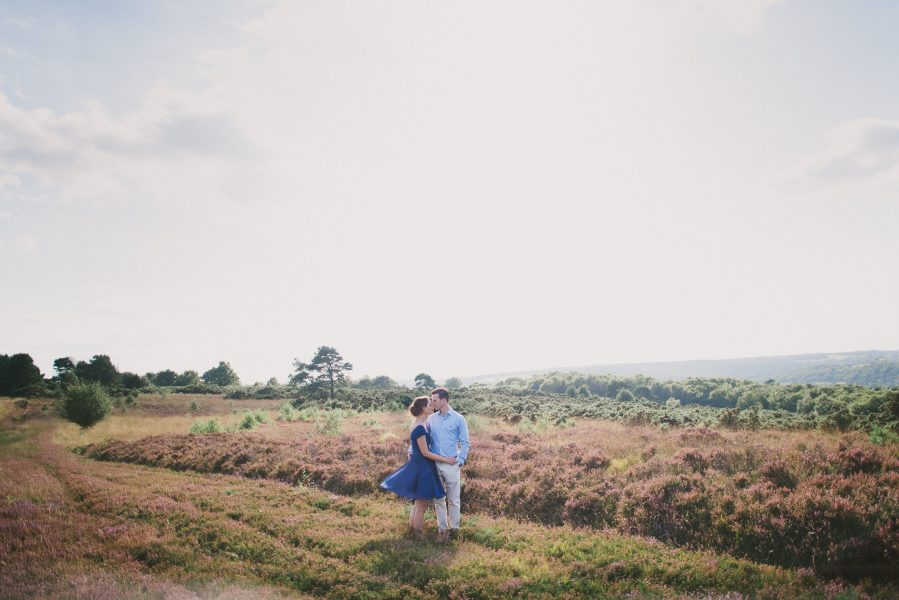 Fine Art engagement shoot of a Bride to be cosying up to Groom to be against a backdrop of heather heath in Ashdown forest