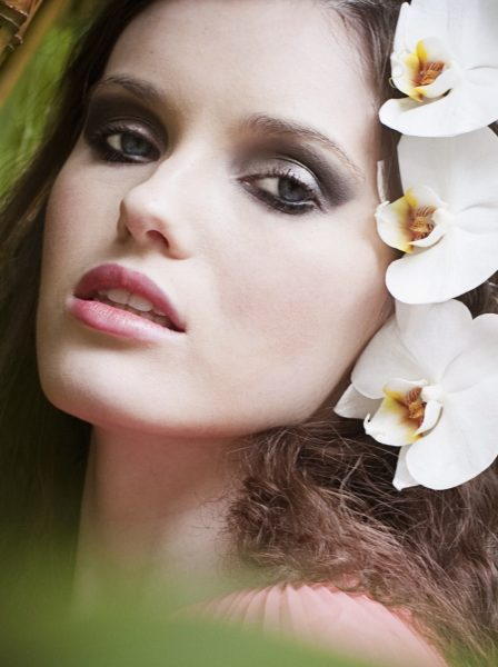 Japanese The Tale of Genji fashion shoot of close up portrait of model with white orchids in her hair