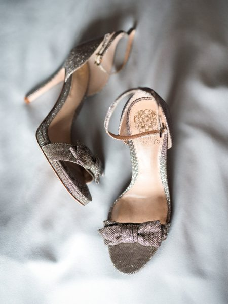 Gold bow wedding shoes on Duck Egg fabric