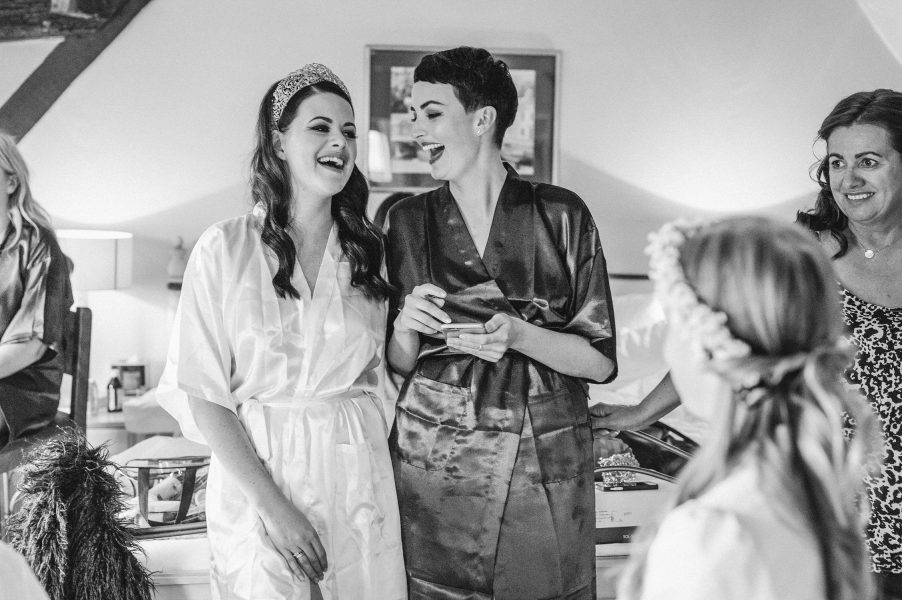 Bride wearing modern wedding crown laughing with Bridesmaid during Bridal Preparations in Hampshire