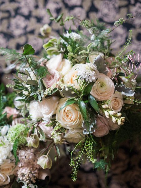 Bouquet of creams and blush rustic ranunculus flowers