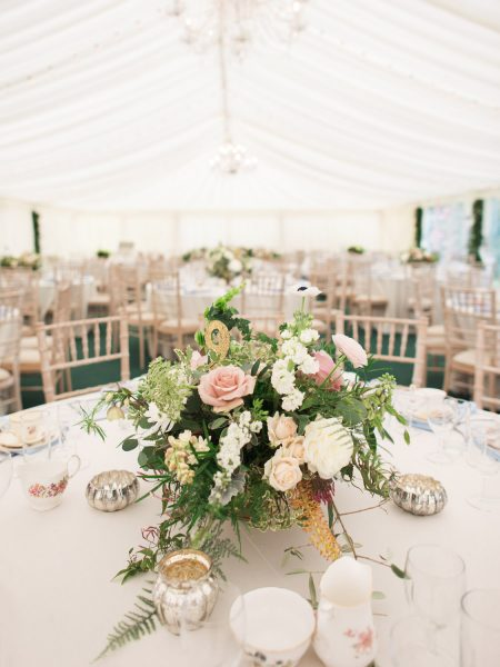 Pink, blush and cream rustic relaxed floral centrepiece in marquee Hampshire