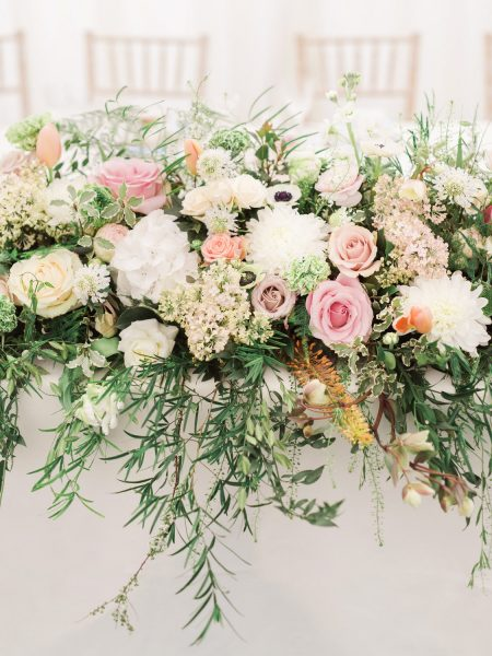 Pink, blush and cream rustic relaxed floral table decor in marquee Hampshire
