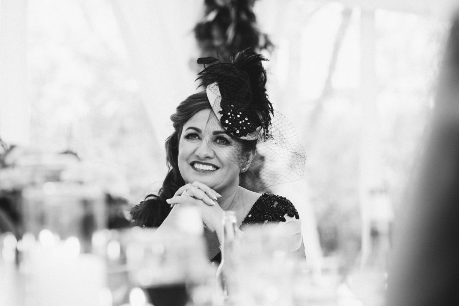 Mother of Bride smiling during wedding speeches