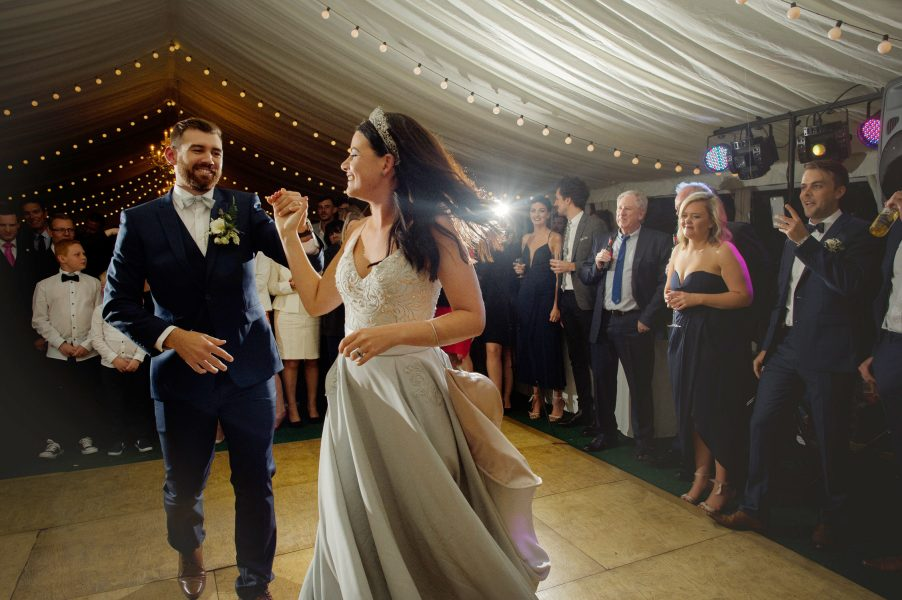 Bride in blue dress and crown and Groom first dance Hampshire