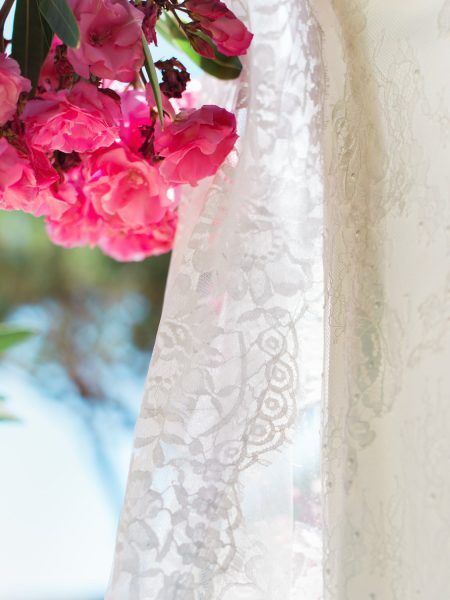 Close up of lace dress with pink flower Algarve Portugal