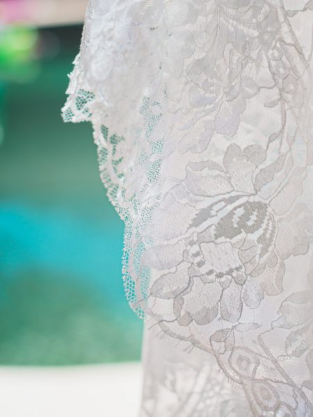 Close up of lace dress hanging next to swimming pool Algarve Portugal