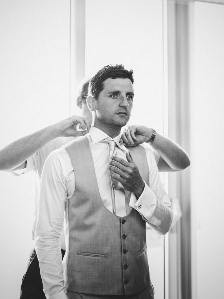 Groom being dressed by stylist in Algarve Portugal