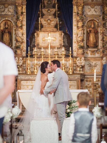 Bride and Groom's first kiss in ornate church in Loule Algarve Portugal