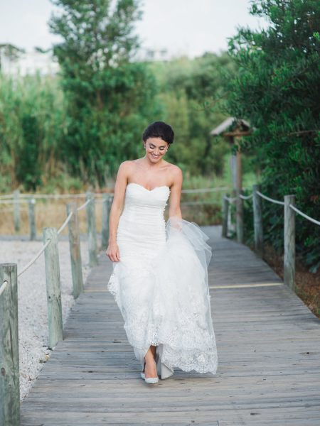 Full length portrait of looking down Bride on wooden beach walkway Quinta Do Lago
