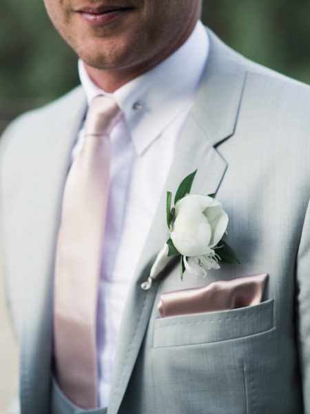 Close up of Groom's button hole, grey suit and pink tie Quinta Do Lago