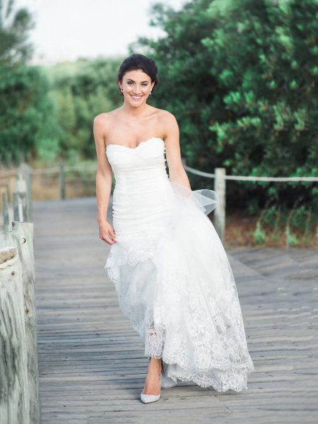 Full length portrait of smiling Bride on wooden beach walkway Quinta Do Lago