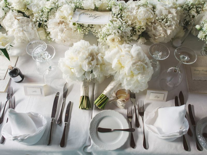 Stylish and elegant top table close up with peony bouquets and white flowers Quinta Do Lago Algarve Portugal