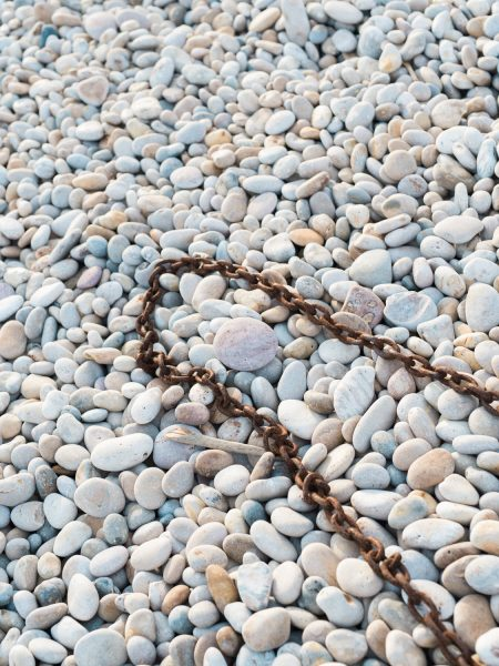 Rusty chain on Chesil beach